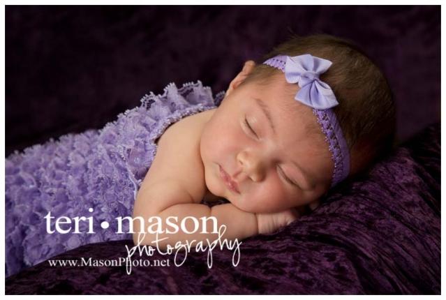 pretty newborn girl in purple