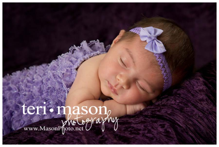 pretty newborn girl in purple
