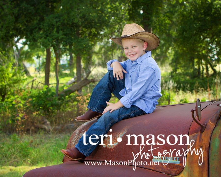 little cowboy on vintage truck